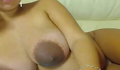 girl that has natural tits is opening up her legs and she is playing with a vibrator