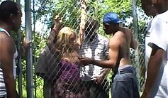Bondage whore in dress gangbanged and facialized by harem
