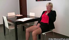 Busty mommy tries on pantyhose and masturbates