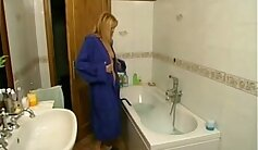 Bath time for this mature blonde