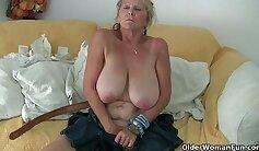 Busty grandmother fingering dildo