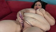 Curly haired brunette whore is fucked with her fat vibrator