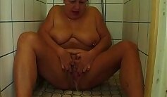 Chubby FTM granny is with Tommy in the shower