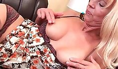 Brooke fucks granny in stockings and heels with toy