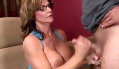 Auburn Mature granny shows her tits