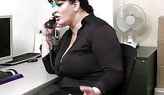 Bosomy redhead sucks hard cock of her boss on his friends desk
