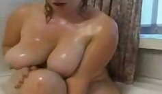 BBW gf plays with her clit and takes shower at work
