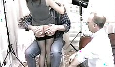 Attractive teen getting spanked on the table