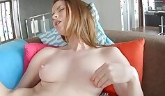 Charming girl working on a dildo