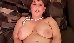 Busty Amateur In Stockings Shows Fat Tits