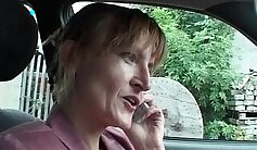 Brunette MILF fucked by her partner in a gangbang